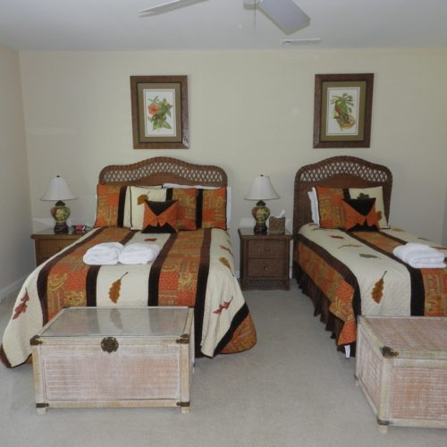 Parrot Room. Full size and twin bed. Sliding doors overlook lagoon