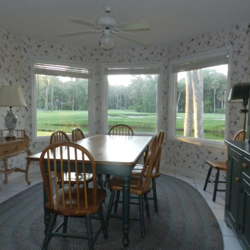 Breakfast room invites interest outside. Birds, leaping fish or golfers