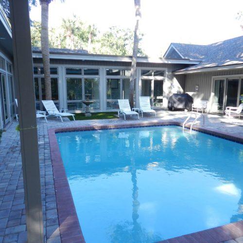 Sunny fenced pool.